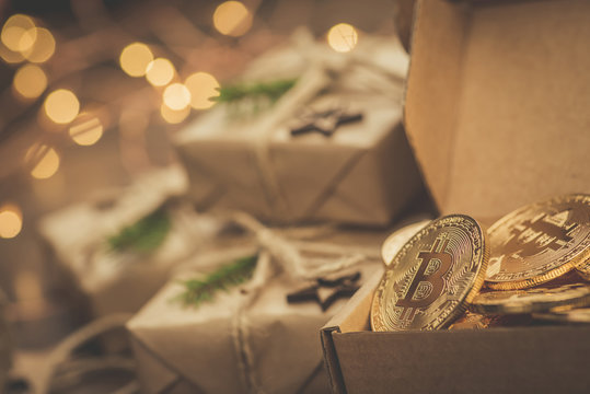 Christmas. Gifts. Bitcoins in a vintage style gift box on a wooden table