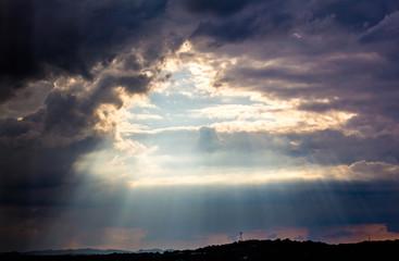 Sun Rays and Dark Clouds