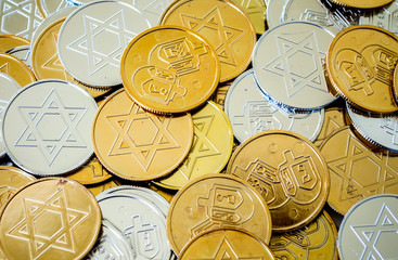 background texture close up full frame of colorful Hanukkah coins