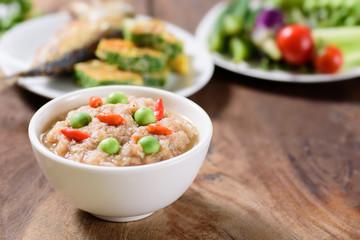 Thai food (Nam Prik Kapi),shrimp paste chili dip with fried mackerel fish omelette and fresh vegetables on wooden background