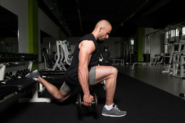 Man With Dumbbells Exercising Quadriceps And Glutes