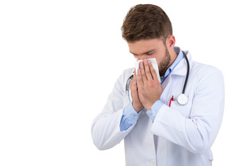 Doctor sneezing isolated against white background
