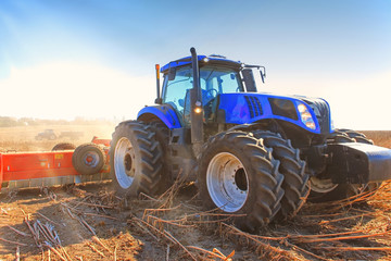 Work of a powerful tractor in field cultivation and cultivation. Agronomy,