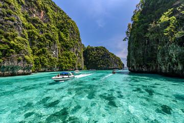 Beautiful crystal clear water at Pileh bay at Phi Phi island in Krabi near Phuket, Thailand. Concept for tropical summer beach travel.