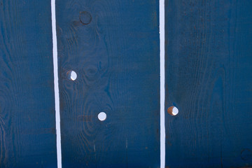 light holes through wooden planks
