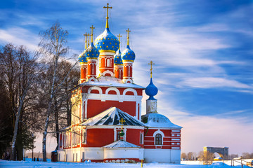 Russian Orthodox Church in Uglich on the background of a cold winter sunny blue sky. Cathedral in the snow covered city.
