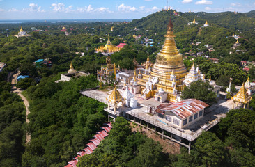 A pagoda is on Sagaing hill, Myamar. Aerial view from the drone.As an important religious and monastic centre