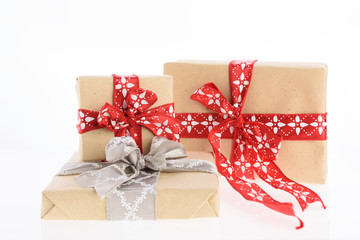 Christmas gift boxes wrapped with red ribbon isolated on white background