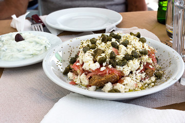 Dakos salad and Tzatziki yogurt sauce, greek meal tipycal. Taken in Naxos