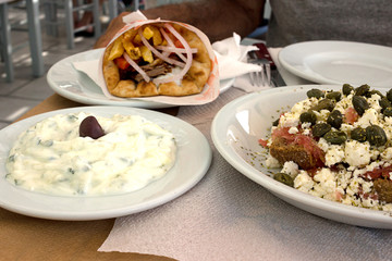 Tzatziki sauce, Gyros Pita and Dakos salad - Typical greek mediterranean dishes