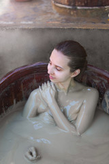 The girl in the mud bath. Concept of relaxation. Nha Trang, Vietnam.