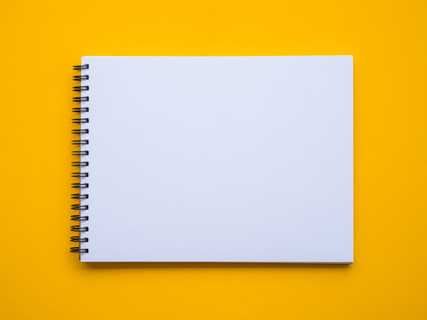 Notepad on yellow background