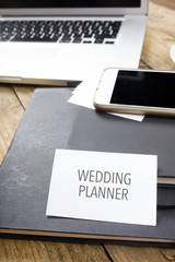 Card saying Wedding Planner on note pad