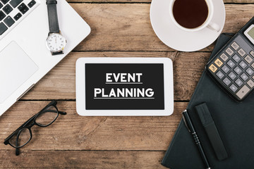 Event Planning text on tablet computer on office desk