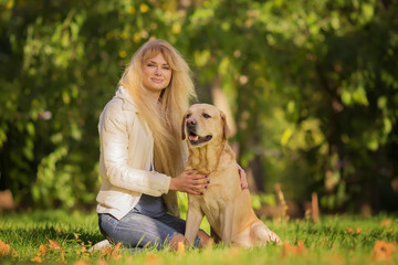 Nice long haired ukrainian girl with her favorite dog in the park