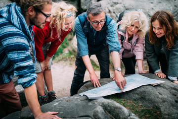 Group of Hikers checking route on map