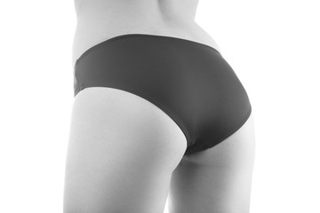 beautiful female buttocks in black panties isolated on white, monochrome