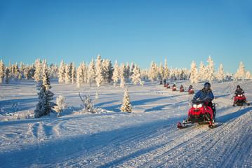 Group of snowmobiles in Lapland, near Saariselka, Finland