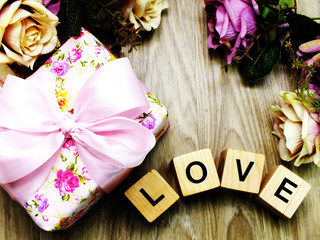 love word wooden block with artificial roses flowers decor and gift box