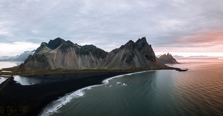 Aerial panorama of the Stokksnes peninsula in Iceland on an overcast day during sunrise