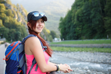 Image of smiling tourist girl with backpack