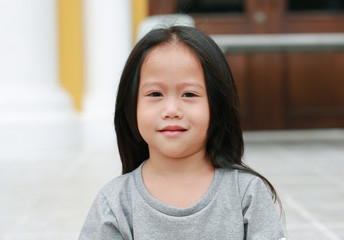 Smiling asian child girl outdoor. Portrait beautiful girl looking at camera.