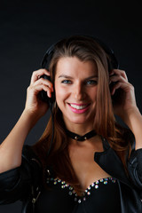 Image of happy model in headphones with leather jacket