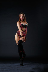 Photo of brunette in swimsuit and in boots