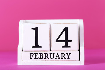 Cube calendar on a pink background