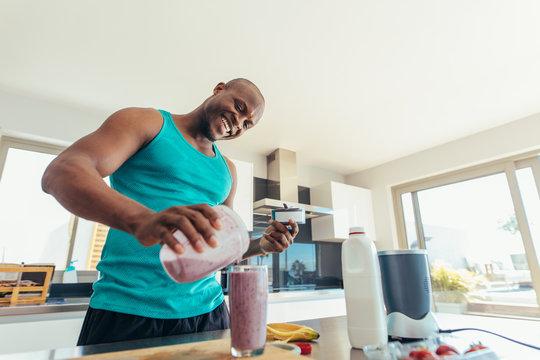 Man preparing breakfast in kitchen