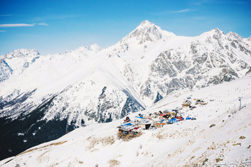 Winter panorama of the mountain with ski slopes. Caucasus. Landscape high peaks in clear weather.