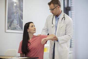 Doctor examiming patient in medical practice