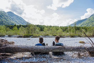 Germany, Bavaria, back view of two hikers having a rest
