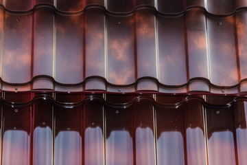 metal sheets of red color to cover the roofs, in the storefront