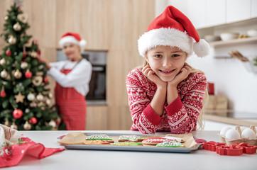 Joyful girl likes special holiday sweet pastry