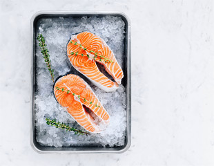 Raw salmon steaks on the ice