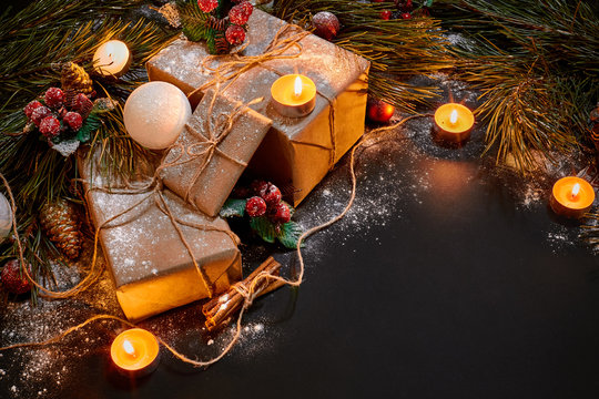 Christmas gifts, christmas tree, candles, colored decor, stars, balls on black background