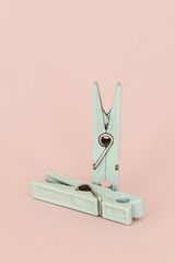 Old Turquoise clothespin on pink background