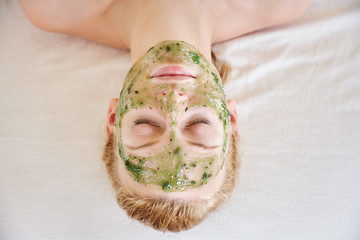 Woman receiving all natural facial at luxury spa