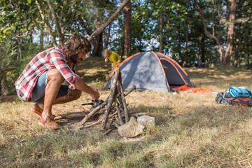 Man setting campfire