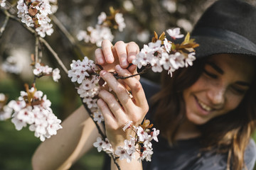Young woman picking up spring flower