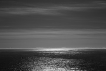 Sunlight reflecting on expansive Pacific Ocean at dusk