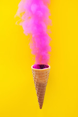 Smoke ice cream on a yellow background.