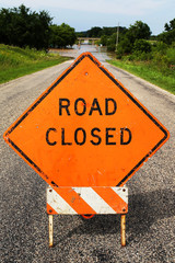 Orange Road Cloased Construction Sign Blocking Flooded Street