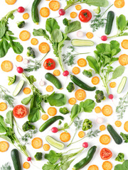Fresh vegetables and greens on a white background. Pattern of vegetables. Radish, carrots, tomatoes, cucumbers, dill isolated on white background. Vegetable background wallpaper.Top view, flat lay.