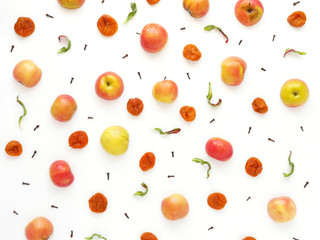 Pattern of red apples and dried dried apricots. The concept of a healthy diet. Composition of fruits on a white background. Top view, flat lay.