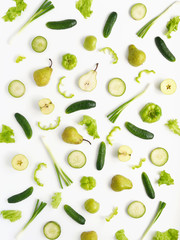Vegetables and fruits on a white background. Pattern of vegetables and fruits. Composition of cucumber, pepper, lettuce leaves, pear, onion, green radish.Top view, flat lay. Food background collage.