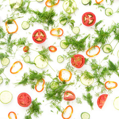 A lot of sliced vegetables and dill.Сomposition of tomatoes, peppers and greens on a white background.Top view, flat lay. Food background. Food wallpaper.