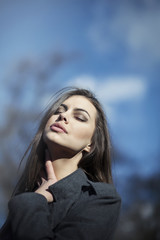 Young beautiful woman with blue eyes and black hair