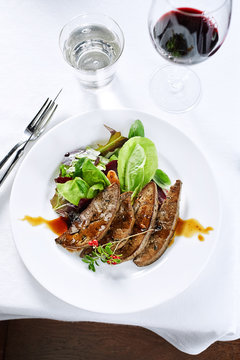 Stir-Fried Liver and Onions with greens served